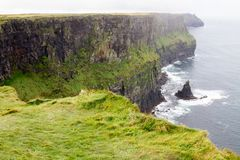 Cliffs of Moher and OBriens Tower Ireland. Beautiful landscape at the famous Cliffs of Moher and  O`Brien`s Tower in Co. Clare, Europe, ireland Stock Photo