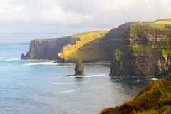 Cliffs of Moher and OBriens Tower Ireland. Beautiful landscape at the famous Cliffs of Moher and  O`Brien`s Tower in Co. Clare, Europe, ireland Stock Photos