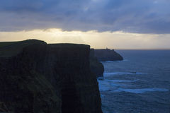 Cliffs of Moher. People admiring the sunset on Cliffs of Moher from Ireland Royalty Free Stock Photos