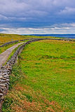 Cliffs of Moher seaside path stone wall and pasture lands overlooking Liscanor Bay Royalty Free Stock Photography