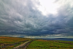 Cliffs of Moher seaside path stone wall and pasture lands overlooking Liscanor Bay Stock Images