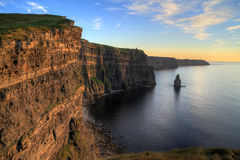 Cliffs of Moher at sunset. Irish Cliffs of Moher at sunset Stock Image