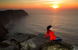 Cliffs of Moher at sunset. Relaxation on Cliffs of Moher at sunset Royalty Free Stock Photography