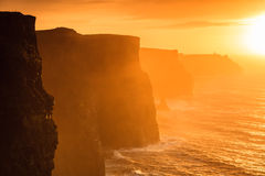 Cliffs of Moher at sunset in Co. Clare, Ireland Europe. Famous cliffs of Moher at sunset in Co. Clare Ireland Europe. Beautiful landscape natural attraction Stock Images