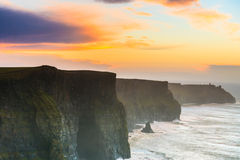 Cliffs of Moher at sunset in Co. Clare Ireland. Europe. Beautiful landscape Royalty Free Stock Images