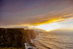 Cliffs of Moher at sunset in Co. Clare Ireland Royalty Free Stock Images