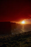 Cliffs of Moher at sunset in Co. Clare Ireland Europe. Famous cliffs of Moher at sunset in Co. Clare Ireland Europe. Beautiful landscape as natural attraction Stock Photography
