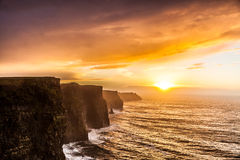 Cliffs of Moher at sunset in Co. Clare, Ireland Europe. Famous cliffs of Moher at sunset in Co. Clare Ireland Europe. Beautiful landscape natural attraction Royalty Free Stock Photography