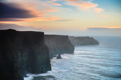 Cliffs of Moher at sunset in Co. Clare, Ireland Europe. Famous cliffs of Moher at sunset in Co. Clare Ireland Europe. Beautiful landscape natural attraction Stock Photo