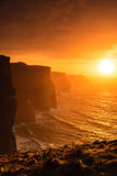 Cliffs of Moher at sunset in Co. Clare, Ireland Europe. Famous cliffs of Moher at sunset in Co. Clare Ireland Europe. Beautiful landscape natural attraction Stock Image