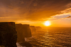 Cliffs of Moher at sunset in Co. Clare, Ireland Europe. Famous cliffs of Moher at sunset in Co. Clare Ireland Europe. Beautiful landscape natural attraction Royalty Free Stock Photos