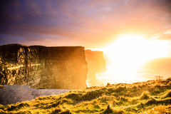 Cliffs of Moher at sunset in Co. Clare, Ireland Europe. Famous cliffs of Moher at sunset in Co. Clare Ireland Europe. Beautiful landscape natural attraction Royalty Free Stock Images