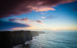 Cliffs of Moher at sunset in Co. Clare Ireland Europe. Famous cliffs of Moher at sunset in Co. Clare Ireland Europe. Beautiful landscape natural attraction Stock Image