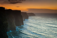 Cliffs of Moher at sunset in Co. Clare Ireland Europe. Royalty Free Stock Photos