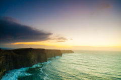 Cliffs of Moher at sunset in Co. Clare Ireland Europe. Famous cliffs of Moher at sunset in Co. Clare Ireland Europe. Beautiful landscape natural attraction Stock Photo