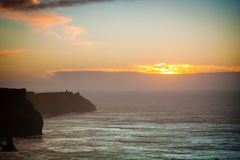 Cliffs of Moher at sunset in Co. Clare Ireland Europe. Famous cliffs of Moher at sunset in Co. Clare Ireland Europe. Beautiful landscape natural attraction Royalty Free Stock Photography