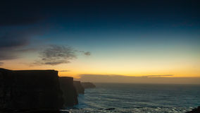 Cliffs of Moher at sunset in Co. Clare Ireland Europe. Famous cliffs of Moher at sunset in Co. Clare Ireland Europe. Beautiful landscape natural attraction Stock Photos