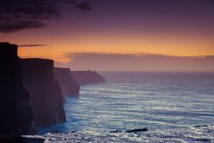 Cliffs of Moher at sunset in Co. Clare Ireland Europe. Famous cliffs of Moher at sunset in Co. Clare Ireland Europe. Beautiful landscape natural attraction Stock Photography