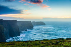 Cliffs of Moher at sunset in Co. Clare Ireland Europe. Famous cliffs of Moher at sunset in Co. Clare Ireland Europe. Beautiful landscape natural attraction Royalty Free Stock Photos