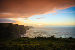 Cliffs of Moher at sunset in Co. Clare Ireland Europe. Famous cliffs of Moher at sunset in Co. Clare Ireland Europe. Beautiful landscape natural attraction Royalty Free Stock Image