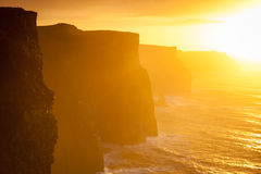 Cliffs of Moher at sunset in Co. Clare Ireland Europe. Famous cliffs of Moher at sunset in Co. Clare Ireland Europe. Beautiful landscape natural attraction Stock Images