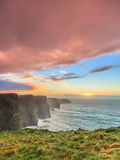 Cliffs of Moher at sunset in Co. Clare Ireland. Famous cliffs of Moher at sunset in Co. Clare Ireland Europe. Beautiful landscape as natural attraction Stock Images