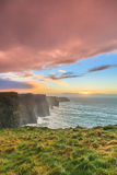 Cliffs of Moher at sunset in Co. Clare Ireland. Famous cliffs of Moher at sunset in Co. Clare Ireland Europe. Beautiful landscape as natural attraction Royalty Free Stock Images