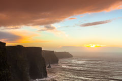 Cliffs of Moher at sunset in Co. Clare Ireland. Famous cliffs of Moher at sunset in Co. Clare Ireland Europe. Beautiful landscape as natural attraction Stock Photography