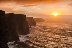 Cliffs of Moher at sunset in Co. Clare Ireland. Famous cliffs of Moher at sunset in Co. Clare Ireland Europe. Beautiful landscape as natural attraction Royalty Free Stock Photography