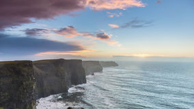 Cliffs of Moher at sunset in Co. Clare Ireland. Famous cliffs of Moher at sunset in Co. Clare Ireland Europe. Beautiful landscape as natural attraction Stock Image