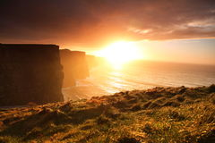Cliffs of Moher at sunset in Co. Clare, Ireland. Famous cliffs of Moher at sunset in Co. Clare Ireland natural attraction Stock Images