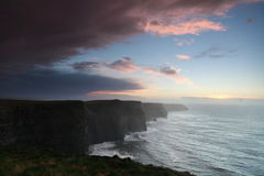 Cliffs of Moher at sunset in Co. Clare, Ireland. Famous cliffs of Moher at sunset in Co. Clare Ireland natural attraction Royalty Free Stock Photo