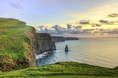 Cliffs of Moher at sunset in Ireland. Popular Cliffs of Moher at sunset in Ireland Royalty Free Stock Image