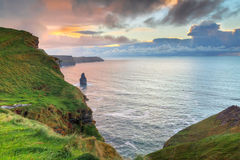 Cliffs of Moher at sunset Stock Photos
