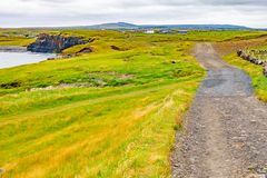 Cliffs of Moher trail with Doolin village and farm fields in background. Clare, Ireland royalty free stock photos