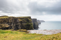 Cliffs of Moher Under a Blue Cloudy Sky. These are the Cliffs of Moher in County Clare, Ireland Stock Images