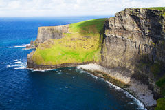 Cliffs of Moher, west coast of Ireland, County Clare at wild atlantic ocean. Stock Photos
