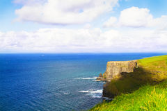 Cliffs of Moher, west coast of Ireland, County Clare at wild atlantic ocean. Royalty Free Stock Photos