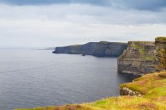 Cliffs of Moher, west coast of Ireland, County Clare on wild Atlantic ocean. Photo of a beautiful scenic sea and sky landscape. View of ocean scenery Stock Photos