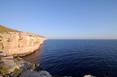 The Cliffs of Mtahleb with Filfla Island Royalty Free Stock Photo