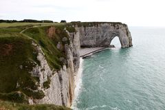 Cliffs and a natural arch Stock Photo