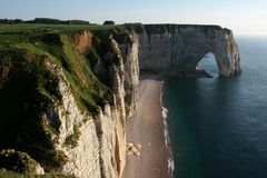 Cliffs and a natural arch Royalty Free Stock Images