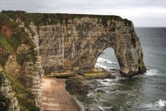 Cliffs and a natural arch. Etretat, Northern France Stock Images
