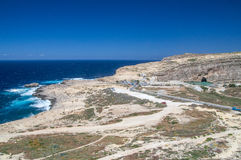 Cliffs near Azure Window at Gozo Island, Malta. Royalty Free Stock Images