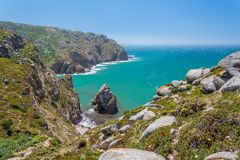 Cliffs near Cabo da Roca, Lisbon, Portugal. Cabo da Roca is a cape which forms the westernmost extent of mainland Portugal, continental Europe and the Eurasian Stock Image