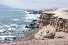 Cliffs near La Portada Natural Monument, Chile Royalty Free Stock Photo