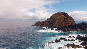 Cliffs near Porto Moniz Madeira aerial view stock footage
