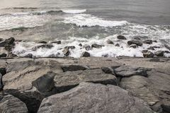 Cliffs near sea and beach waves. In nature stock photo