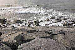 Cliffs near sea and beach waves. In nature royalty free stock photography
