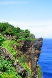 Cliffs near Uluwatu Temple on Bali, Indonesia. Beautiful blossom Uluwatu Temple on Bali, Indonesia. Royalty Free Stock Images